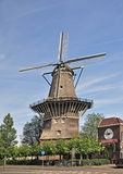 A Windmill in Amsterdam. Windmills were at one time a major source of power in Holland and a few are still to be seen around Amstrdam and the countryside Royalty Free Stock Photo