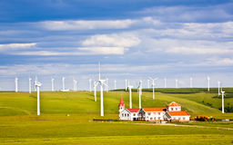 Windmill And House In The Grassland Royalty Free Stock Photos