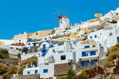 Windmill and apartments in Oia, Santorini, Greece. Windmill and eclectic style apartments in Oia town, Santorini island, Greece Royalty Free Stock Photos