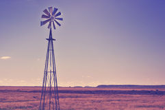 Windmill in the arid landscape Royalty Free Stock Photo