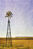 Windmill in the arid landscape, texture added Stock Photo