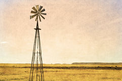 Windmill in the arid landscape, texture added Stock Photos