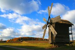 Windmill - Autumn Landscape. Windmill over meadow , Autumn Landscape, beautiful vivid nature Royalty Free Stock Photography