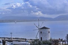 Windmill in the Bay at Corfu town on the the Greek island of Corfu. The city of Corfu stands on the broad part of a peninsula, whose termination in the Venetian Stock Images