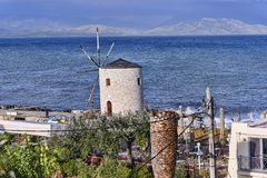 Windmill in the Bay at Corfu town on the the Greek island of Corfu. The city of Corfu stands on the broad part of a peninsula, whose termination in the Venetian Stock Photos