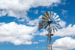 Windmill and beautiful blue sky, USA. Royalty Free Stock Images