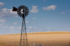 Windmill, beautiful day, outback. Australia, blue sky. A windmill standing tall on a beautiful day captured our eye while travelling between Bathurst and Orange Stock Photo