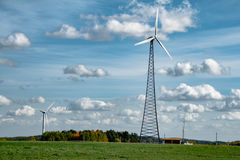 Windmill. Beautiful landscape of windmills on the field against the blue sky and clouds. / Windmill. / Belarus Stock Photography