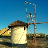 Windmill. A beautiful portuguese windmill by the sea Stock Photos