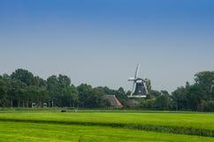 Windmill Behind Farmland Horizontal Royalty Free Stock Images