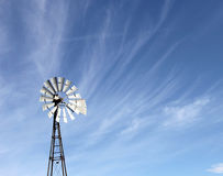 Windmill blowing cirrus clouds Royalty Free Stock Photos