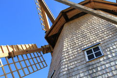 Windmill on blue skies. An old wooden windmill on a deep blue sky Royalty Free Stock Photos