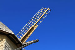 Windmill on blue skies. An old wooden windmill on a deep blue sky Royalty Free Stock Photo