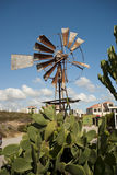 Windmill with blue skies overhead Stock Image