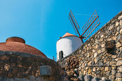 Windmill on blue sky background in cactus garden, Guatiza village, Lanzarote royalty free stock image