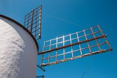 Windmill on blue sky background in cactus garden, Guatiza village, Lanzarote Royalty Free Stock Photos