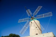 Windmill on a blue sky background on Gozo Island, Malta. Europe royalty free stock images