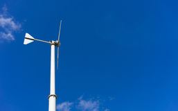 Windmill with blue sky and cloud Stock Photo