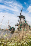 Windmill. Among blue sky in Netherland Stock Photo