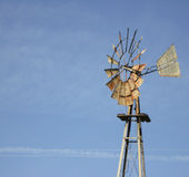 Windmill with blue sky. Rusty old windmill isolated on blue sky with copy space Royalty Free Stock Photography