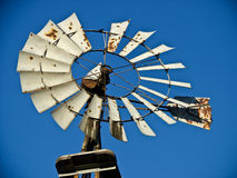 Windmill Blue Sky. Rusty old windmill on my farm Stock Images