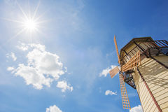 Windmill and blue sky with sun star background. Royalty Free Stock Photo