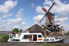 Windmill and boat Royalty Free Stock Images