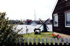 Windmill and boat. Windmill in Zaanse Schans ethnographic museum in Netherlands royalty free stock images