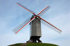 Windmill in Bruges, Belgium. Shot on blue sky background Royalty Free Stock Photos