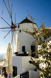 Windmill cafe over the caldera Royalty Free Stock Photography