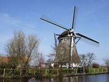 Windmill in the Netherlands. Windmill called De Valk in the Dutch village of Berkel en Rodenrijs Stock Photo
