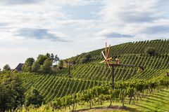 Windmill called Klapotetz in vineyard along the south Styrian vi. Ne route in Austria, Europe Royalty Free Stock Photography