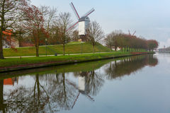 Windmill and canal in Bruges, Belgium Royalty Free Stock Images