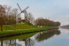 Windmill and canal in Bruges, Belgium Royalty Free Stock Photo