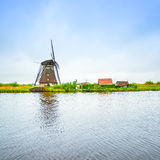 Windmill and canal in Kinderdijk, Holland or Netherlands. Unesco site Royalty Free Stock Photos