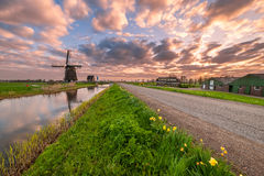 Windmill and Canal on Traditional Holland Landscape. Beautiful morning with bright clouds. Fine country for travel stock photos