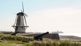 Windmill and canons in Holland royalty free stock photo
