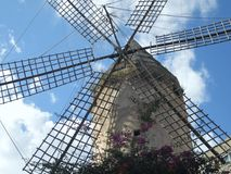 Windmill of Castile. In Spain the windmill is a stone structure of cylindrical shape which supports an upper part which supports the blades that transform the Royalty Free Stock Photo