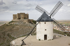 Windmill and the Castle in Consuegra town, province of Toledo, Castilla-La Mancha, Spain Royalty Free Stock Photos