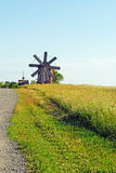 Windmill  and church in Kizhi Royalty Free Stock Photo