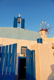 Windmill and church in Oia, Santorini Royalty Free Stock Image