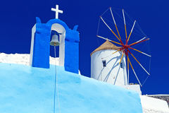 Windmill at the church on Santorini island Royalty Free Stock Photo