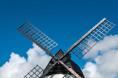 Windmill close up, with black sails and blue sky Stock Photo