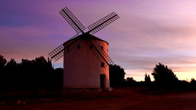 Windmill colors at dawn. Tipical spanish windmill Stock Photo