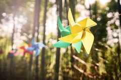 Windmill colors in the woods. 。Toy windmill Stock Photography