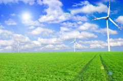 Windmill conceptual image. Windmills on the green field Royalty Free Stock Photography