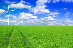 Windmill conceptual image. Windmills on the green field Stock Photography