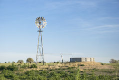 Windmill and Concrete Tank Stock Photo