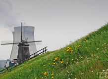 Windmill and cooling towers Royalty Free Stock Photos