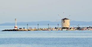 Windmill on sea wall, Corfu, Greece Royalty Free Stock Photos